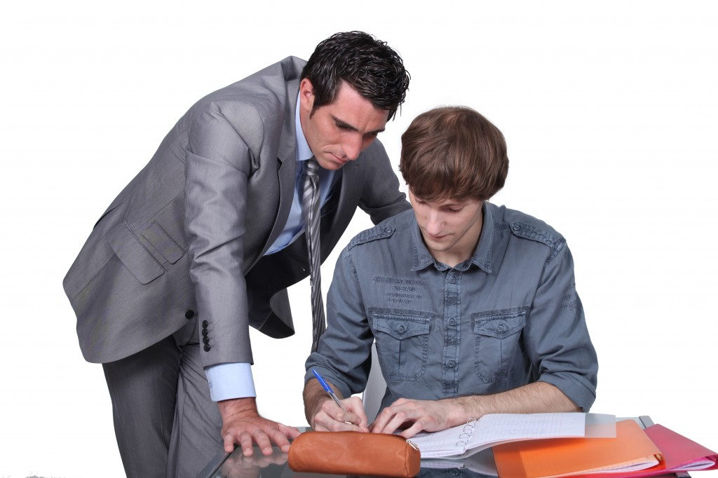 Teacher helping a student with his studies
